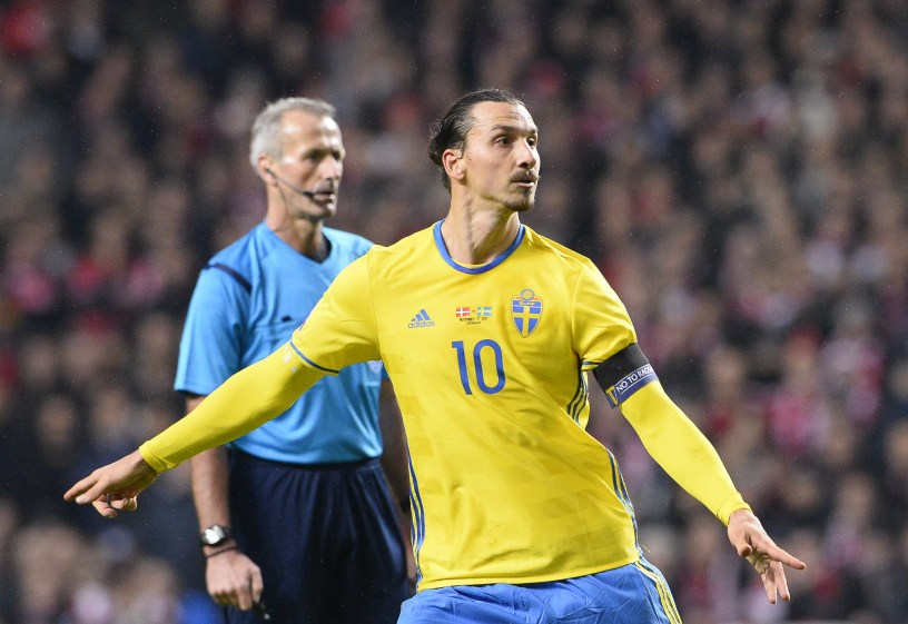 Sweden's forward and team captain Zlatan Ibrahimovic celebrates after scoring his second goal during a second leg play-off football match between Denmark and Sweden at Parken stadium in Copenhagen on November 17, 2015. AFP PHOTO / JONATHAN NACKSTRAND